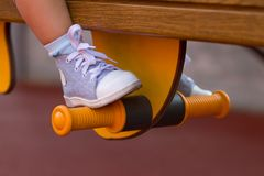 Legs of little kid on the playground Royalty Free Stock Photos