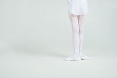 Legs of little  young ballerina poses on camera Royalty Free Stock Photo