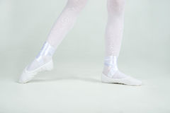 Legs of little  young ballerina poses on camera Royalty Free Stock Images