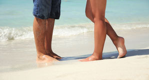 Legs in love couple on the beach Royalty Free Stock Photos