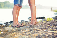 Legs lovers on the beach. Legs lovers on the bank of the river Royalty Free Stock Photography