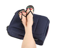 Legs lying on the blue suitcase Royalty Free Stock Images