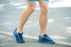 Legs of male athlete runner jogging park sidewalk. Active lifestyle training cardio sport shoes. Vascular disease. Varicose veins problems active life. Prevent Royalty Free Stock Images