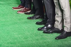Legs of male models standing. Male models with brogues standing in a fashion show, athens, greece Royalty Free Stock Photography