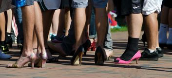 Legs of male runners preparing for a race on heels.  Royalty Free Stock Photos