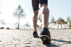 Legs of male sportsman running in the city Royalty Free Stock Photography