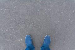 Legs of man on the asphalt Stock Photos