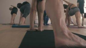 Legs of a man doing yoga asana. Trikonasana. Close up legs of a man doing yoga asana, 4K. Trikonasana stock video