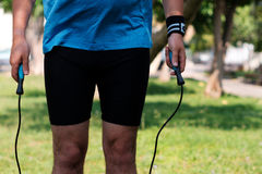Legs of a man with jump rope Stock Image