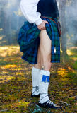 Legs of the man in kilt Stock Images
