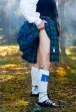 Legs of the man in kilt Stock Images