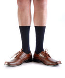 Legs from a man with open feet. Legs from a businessman without his pants. White background Royalty Free Stock Images