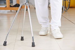 Legs of a man in physiotherapy. Legs of a man with crutches as support in physiotherapy royalty free stock image