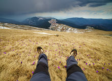 Legs of a man resting on mountains Royalty Free Stock Photos