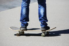 Legs of a man rolling on a roller Board stock image