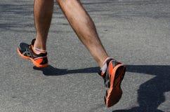 Legs of a man running. On an asphalt path royalty free stock photos