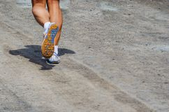 Legs of a man running. On a path royalty free stock photo