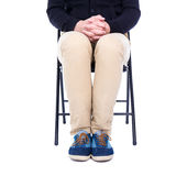 Legs of man sitting on office chair isolated on white. Background Stock Photo