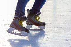 Legs of a man skating on an ice rink. Sport and entertainment. Rest and winter holidays