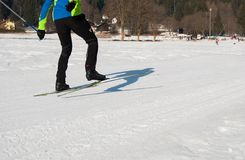 Legs of a man skiing during competition in a sunny day royalty free stock photo