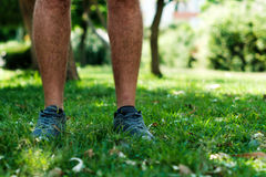 Legs of a man with sport shoes Royalty Free Stock Image
