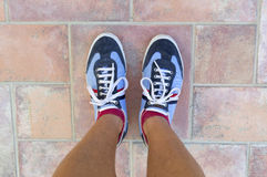 Legs of a man. With sports shoes stock image