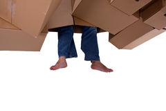 Legs of man standing among cardboards Royalty Free Stock Photography