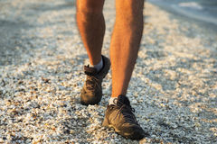 Legs of a man walking on the beach Royalty Free Stock Photos