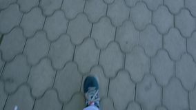 The legs of a man walking on the road,the first person stock footage