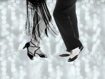 Legs of man and woman dancing. Couple dancing swing dancing Stock Photography