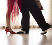 Legs of man and woman dancing. Dance partner. Man and woman dancing.Dancing couple dancing latin rhythms Stock Images