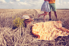 Legs of man and woman in the fields Stock Image