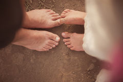 Legs of man and woman near each other. Royalty Free Stock Image