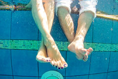 Legs of man and woman in the pool underwater.  Stock Images