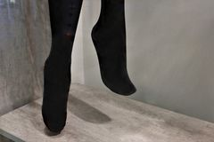 Legs of a mannequin in black pantyhose stock photography