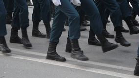 Legs on the March of the Military. A close-up of the feet of military men who march on the parade on May 9, 2018 in a slow motion shot. Same clothes and shoes stock video footage