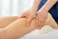 Legs massage Stock Photos