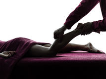 Legs massage therapy silhouette Stock Images
