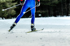 Legs men skier. Athlete competitions in cross-country skiing classic style Stock Photos