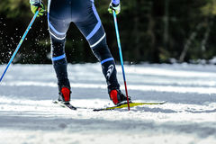 Legs men skier. Athlete ski racing competitions spray snow behind Royalty Free Stock Image