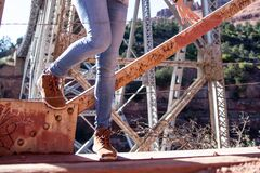 Legs on metal bridge Stock Image