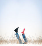 Legs with missing boot in air in winter day. Royalty Free Stock Photo