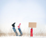 Legs with missing boot in air on winter day. Royalty Free Stock Photo
