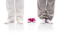 Legs of a mother and a father and small child's shoes Royalty Free Stock Images