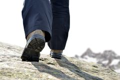 The legs of a mountain hiker with hiking boots. Royalty Free Stock Photography