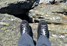 Legs of a mountain hiker with hiking boots. Royalty Free Stock Images