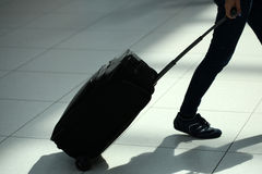 Legs moving with rolling suitcase Royalty Free Stock Photography