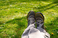 Legs in nature. Legs sitting in nature, relaxing Stock Image