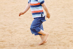 Legs od barefoot of little boy in shorts running Stock Photography
