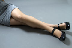Legs Of A Woman In A Dress With Black Shoes Stock Images